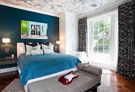 View in gallery Posh boys' bedroom with a beautiful blue accent wall and  creative ceiling [Design: