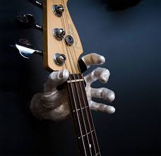 the hand guitar wall holder is a guitar holder that is shaped like a hand that you can attach to your wall and hang your guitar to it