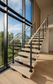 modern floating staircase with glass infill railing