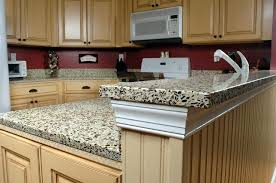 chic kitchen decoration with cabinets and recycled glass countertops plus red backsplash and floating oven