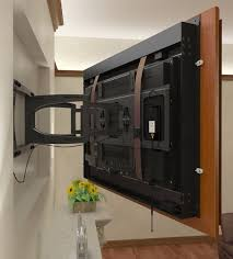 recessed tv using a swing arm mount with the frame attached to the tv .