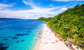 the uping six month closure of borocay island the most por tourist destination in the philippines will likely have a negative short term but