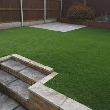the client wanted the stone removing the area levelling and artificial turf laying the result was a usable area that