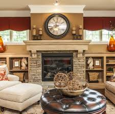 fireplace idea-- could put tv over mantle and then decorate the tops of  bookshelves
