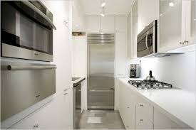 modular kitchen colors: engaging futuristic white beauteous futuristic parallel modular kitchen white color kitchen cabinets silver color metal knobs countertop stoves mounted microwave built in oven coffee maker built in fridge composite kitchen sin