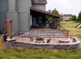 cedar shake shingled covered evergrain weathered wood deck with baroque baers flagstone steps