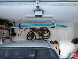 you quickly realise there is no room in the garage the only spare space is the ceiling so you get to work on a sup hoist the results below cheers oldboy