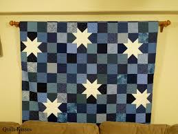 Quilt Kisses: Different Ways to Hang Quilts & I have also used other styles of drapery rods to hang quilts. This one is  in my basement. Adamdwight.com