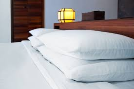 How to Wash Polyester-Filled Bed Pillows
