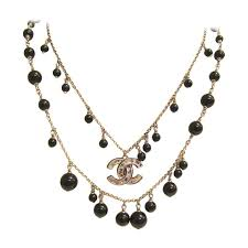 chanel necklace. chanel necklace - double strand alternating black beads cc logo 1 w