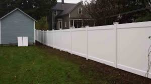 fence retaining wall and privacy fence ajb landscaping u fencerhajbservicecom building build a on sloped ground