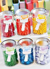 candy bar take home treat rainbow paint party candy displayed in clear plastic paint cans from craft