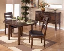 larchmont round dropleaf dining room set
