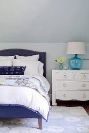 blue camelback bed with white lacquered nightstand view full size
