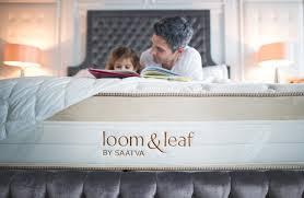 saatva mattress sagging.  Mattress A Father And Daughter Reading On The Bed With Saatva Mattress Sagging