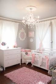pink and white furniture. this gray and pink nursery was done on a small white furniture