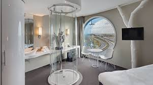 A transparent shower in the middle of a guest room at the Fletcher. Credit  Herman Wouters for The New York Times