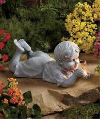 solar boy garden statue designs