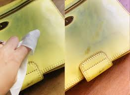 to clean leather purse from jeans stain