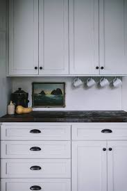 leave enough space between the countertop and wall cabinets to work but not so much