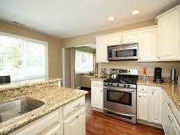 kitchen stainless steel sink under pendant lamps black oven cabinet brown wooden kitchen island dark