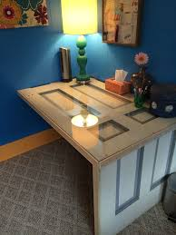homemade desk made out of an old door i found at our local re purpose