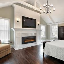 modern electric fireplace insert with black frame and luxury mantel kit with wooden floor for home