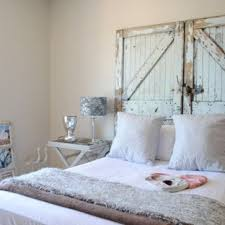 inspiration for a shabby chic style bedroom remodel with beige walls