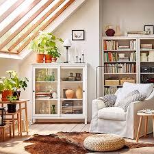 shelving furniture living room. Spacious And Comfortable White FÄRLÖV Armchair HEMNES Glass-door Cabinet In A Room Shelving Furniture Living