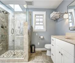 new tile shower with frameless glass shower doors and wall