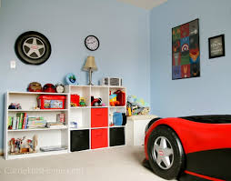 i repurposed one of the car bed wheels and hung it up above his bookshelf to help bring the car theme to that side of the room
