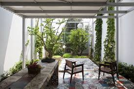 The usual options would be to transform this awkward little area into a patio or a courtyard, but decking can be used successfully to enhance smaller gardens too. The Cult Of The Courtyard 10 Backyard Ideas For Small Spaces Gardenista
