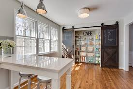 sliding barn doors fit in perfectly with the ambiance of even modern kitchens design