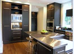 view in gallery stainless steel countertops brighten a kitchen with black cabinetry