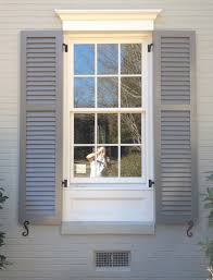 plantation shutters orlando lakeland painted wood shutters 3 1 2 elliptical louver tilt