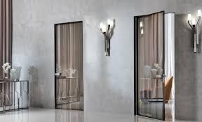 Двери без наличников Модели двусторонних скрытых полотен изготавливают ориентируясь на толщину межкомнатного перестенка На практике ширина короба варьируется от 7 5 до 10 см