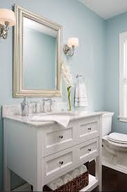 coastal style bath lighting. cape cod cottage remodel love that champagne gold oversize mirror in this powder room coastal style bath lighting r