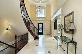 glamorous home foyer with marble flooring and two level staircase