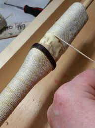 if so desired additional smaller risers can be added to the sword handle wrap using hemp cord soaked in wood glue which when it dries has the consistency