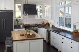 small kitchen design with white cabinets and grey countertop combination with small island