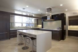 Modern L Shaped Kitchen With An Island And Recessed Lights