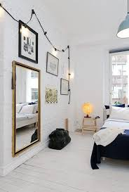 view in gallery create contrasts in your bedroom with black string lights on a white wall