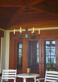 exterior porch ceiling lighting. tudor style exterior chandelier hand from the ceiling on porch of house. lighting
