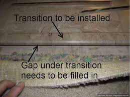 laminate tile flooring over ceramic tile installing transition needs to be modified for the higher