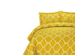 above the lattice bedding set features a graphic pattern in a dijon yellow on 100 percent cotton 300 thread count fabric the set includes a duvet cover