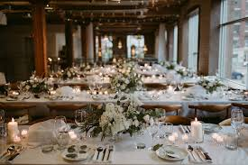 Long Tables Set Up For Wedding Reception Inside Old Building