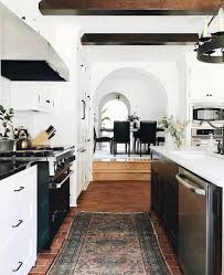 Gorgeous white kitchen with dark beams | Perfect Home Essentials ...