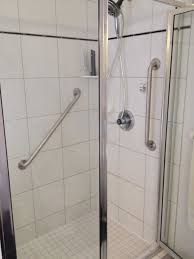 handicap rails for bathroom. gorgeous image of bathroom decoration using square white tile wall including steel framed glass shower door and stainless handicap rails for