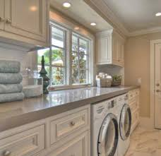 utility room lighting. utility room good counter top space and like the recessed lighting white cabinets with grey counters great in this use but seeing it for e