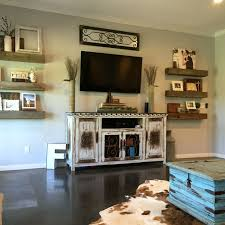 barnwood shelves floating shelves rustic decor cowhide rug farmhouse decorating around